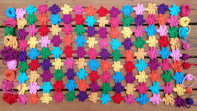 yarn for two rows of crochet flowers for a join as you go crochet shawl