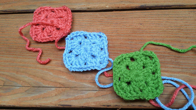 three two-round granny squares crochet squares