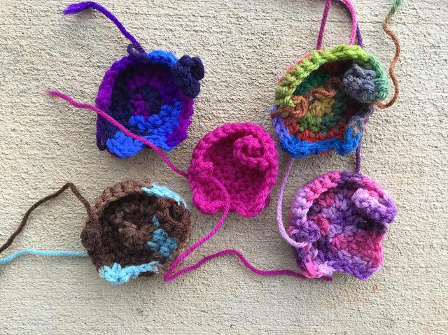 five crochet elephants