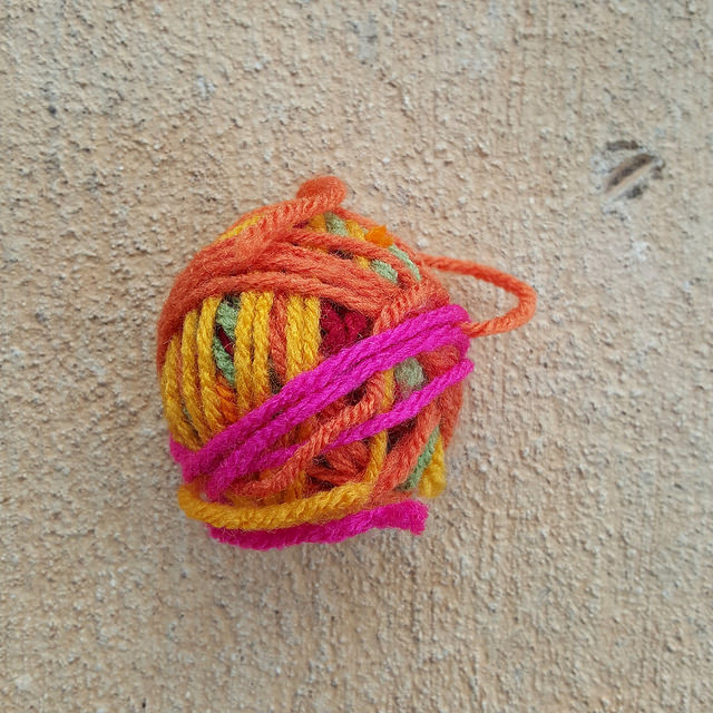 yarn scraps wound into a yarn ball