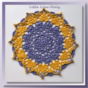 Little Lilac Doily - A petite textured doily encircled with gold crowns - CrochetMemories.com