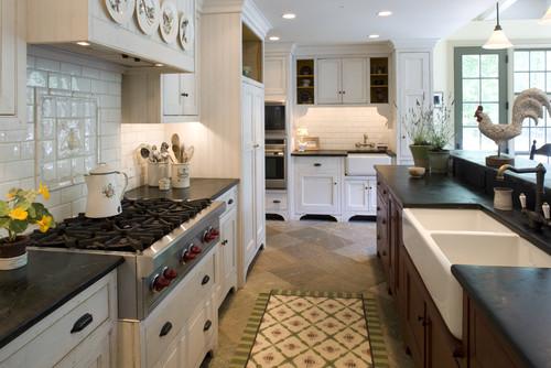 Black Soapstone Kitchen With White Subway Tile Backsplash