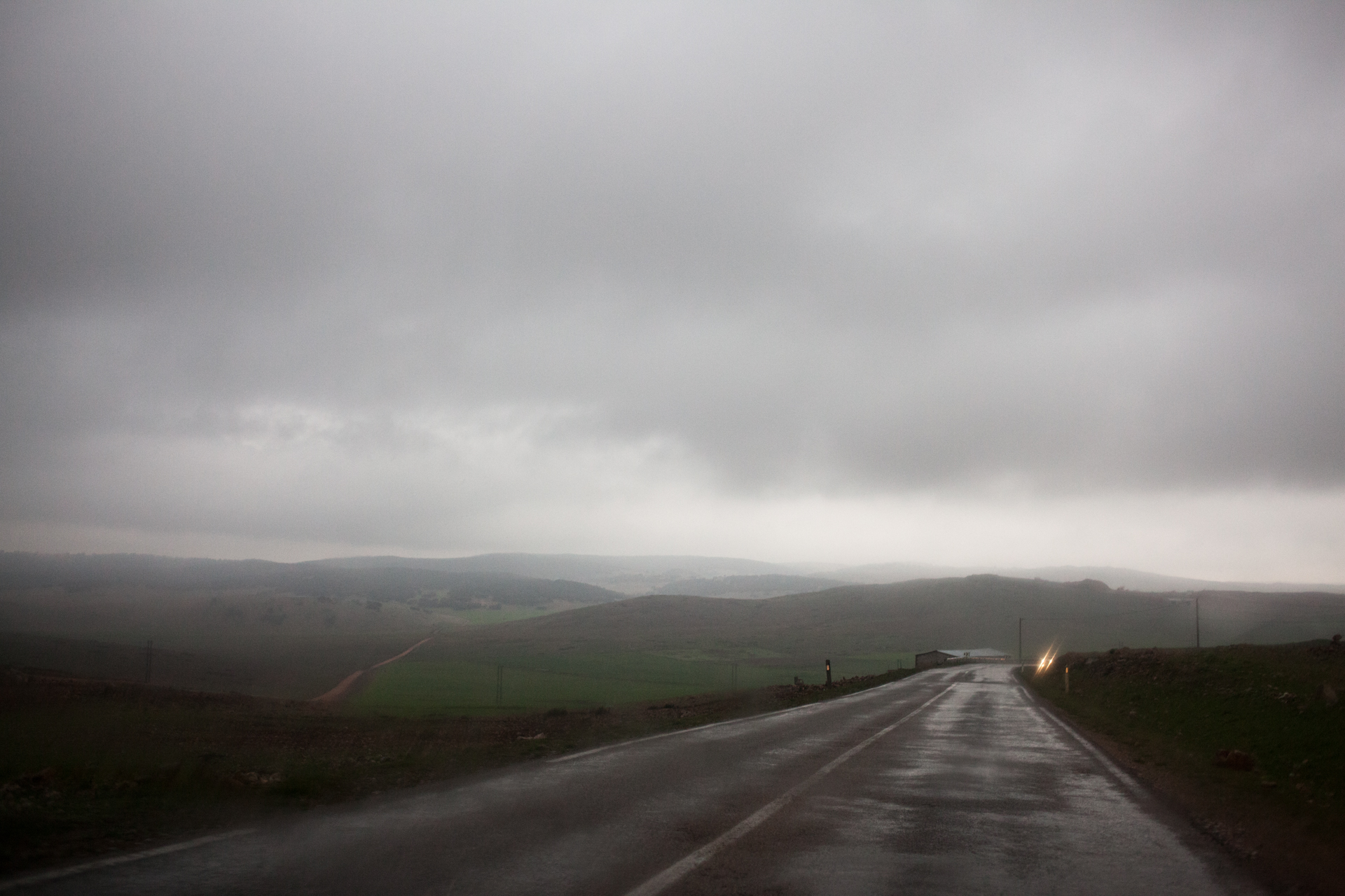 A gloomy road in front of us.