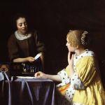 Joven y sirvienta con una carta