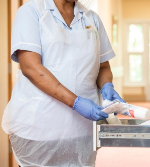 White Aprons and Blue Vinyl and Blue Nitrile Gloves