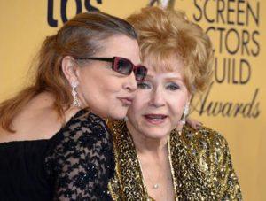 Morte a 24 ore una dall'altra, Carrie Fisher, 60 anni, Debbie Reynolds, 84: colpo al cuore e crepacuore
