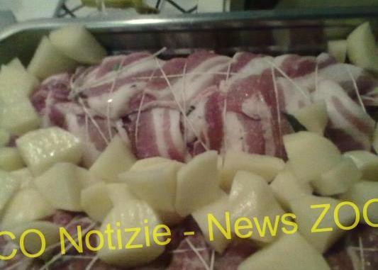 arrosto di maiale ripieno di crema di spinaci e ricotta ricoperto di patate
