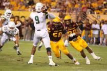 Arizona State linebackers Salamo Fiso (58) and Laiu Moeakiola (28) pursue Cal Poly quarterback Chris Brown. (Photo: Scotty Bara/WCSN)
