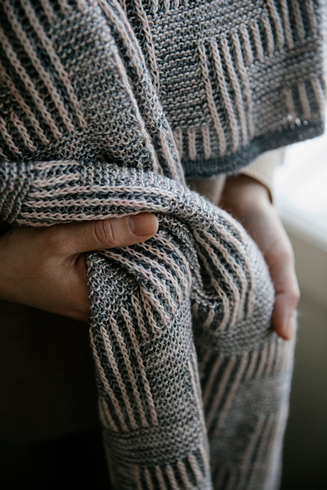 close up from a white woman modeling a striped shawl of Laine Publishing - 52 Weeks of Shawls