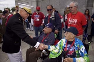 Veterans arrive at memorials in the district