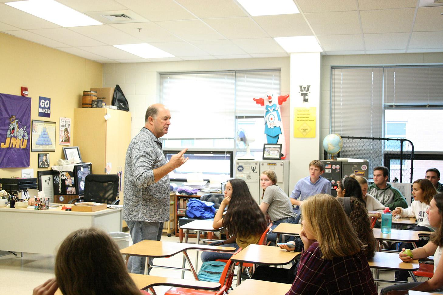 Mr. Doug Grove gives a lecture to third period IB Psych students.