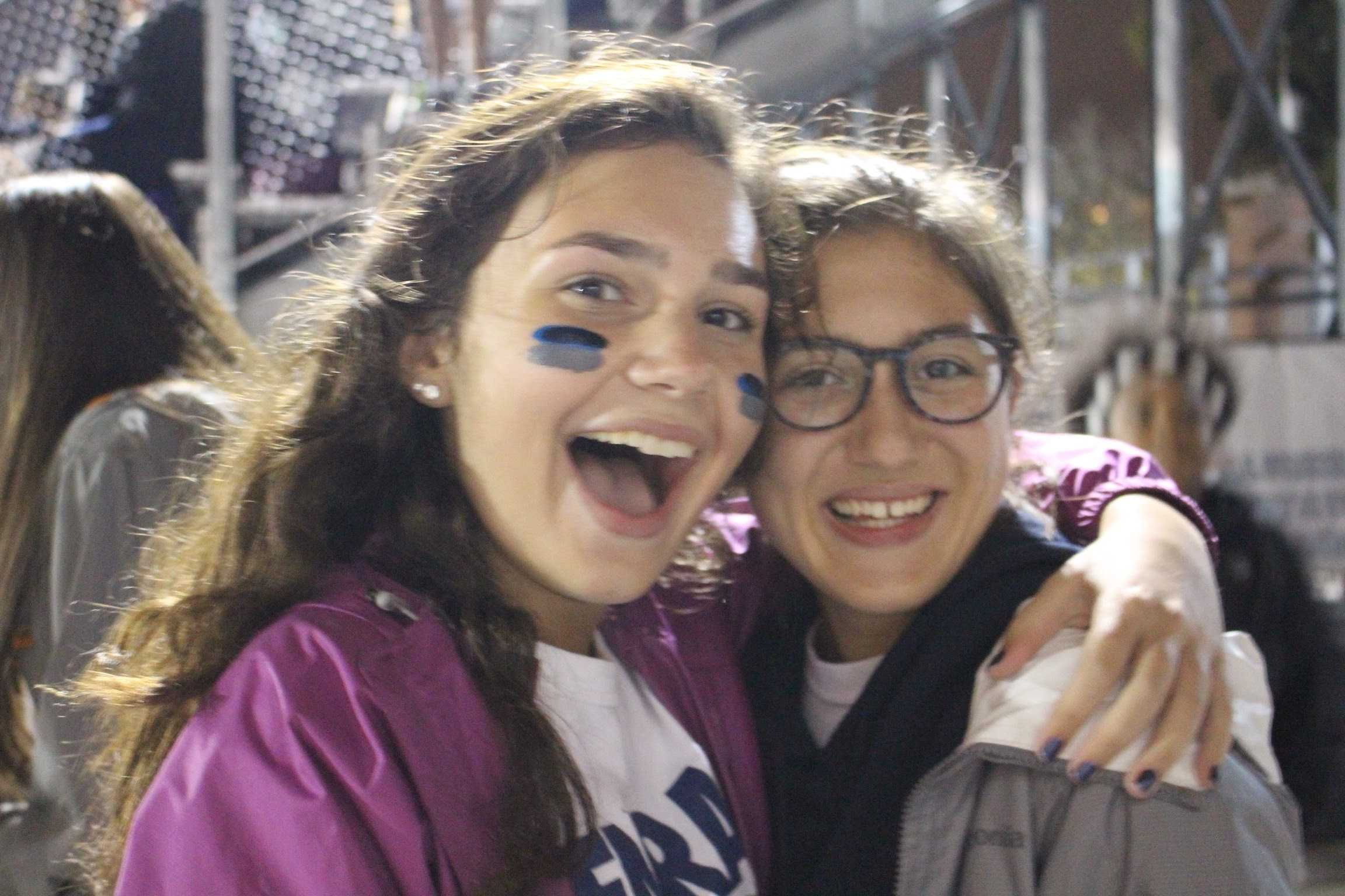 Two football fans at the homecoming game