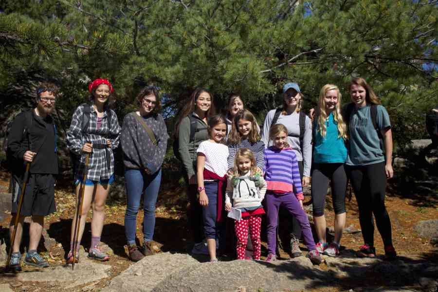 W-L+students+and+the+children+of+IB+Philosophy+teacher+Mr.+Summers+pose+at+the+top+of+Old+Rag+Mountain+in+Nethers%2C+Virginia+after+a+nearly+four+hour+trek.