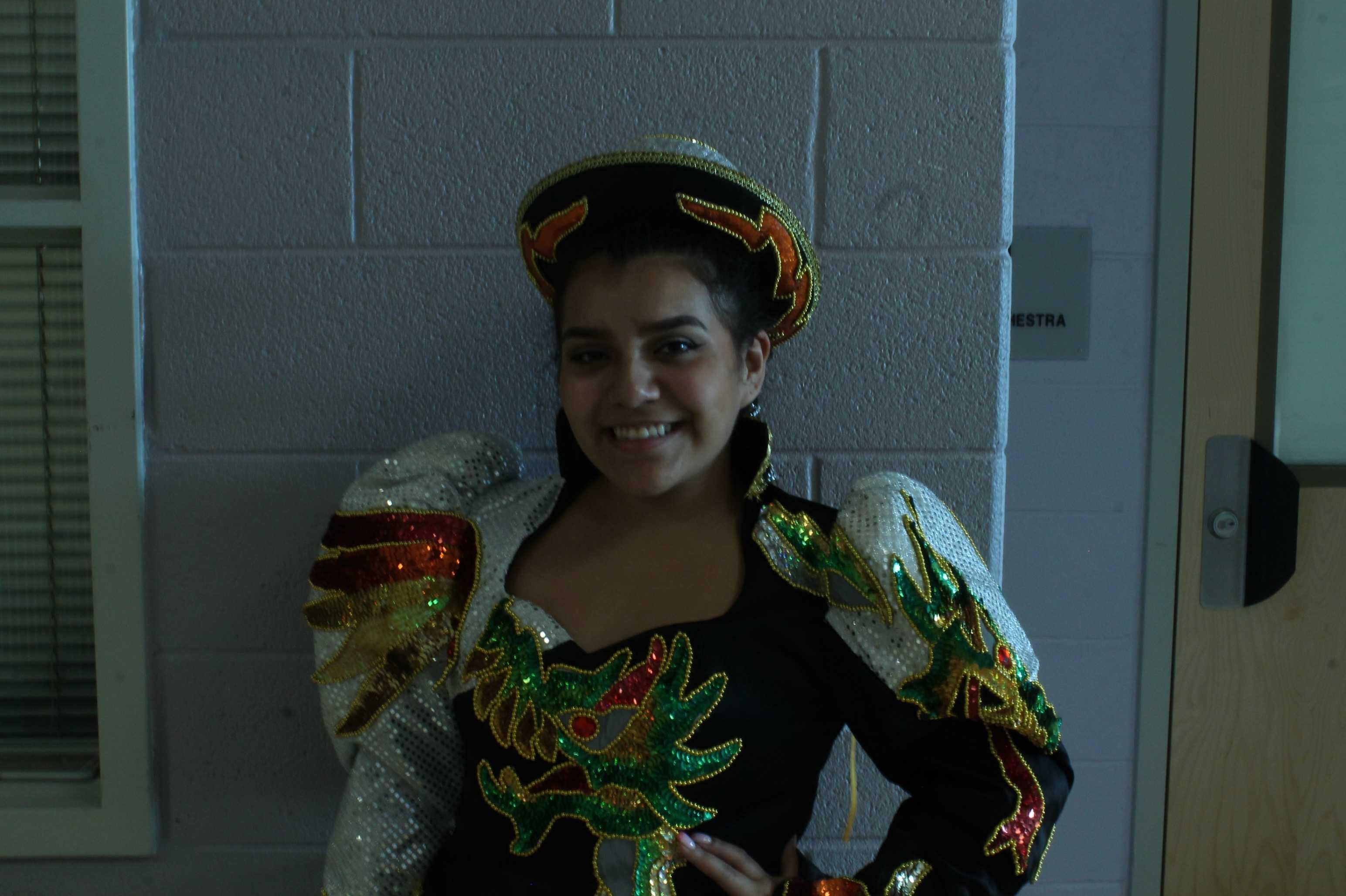 Junior Karen Torrico prepares for a traditional Bolivian dance.