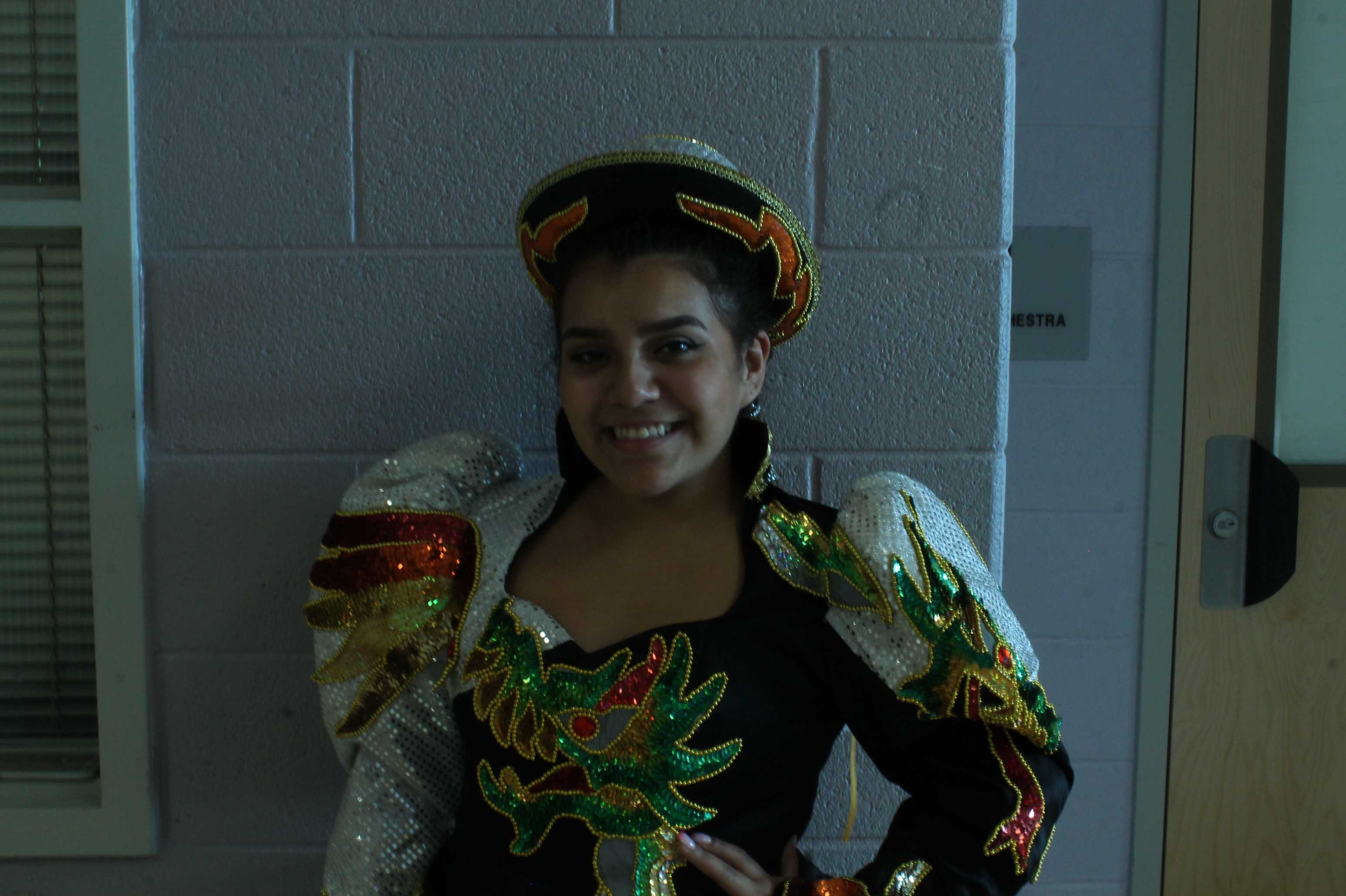 Junior Karen Torrico prepares for a traditional Bolivian dance.