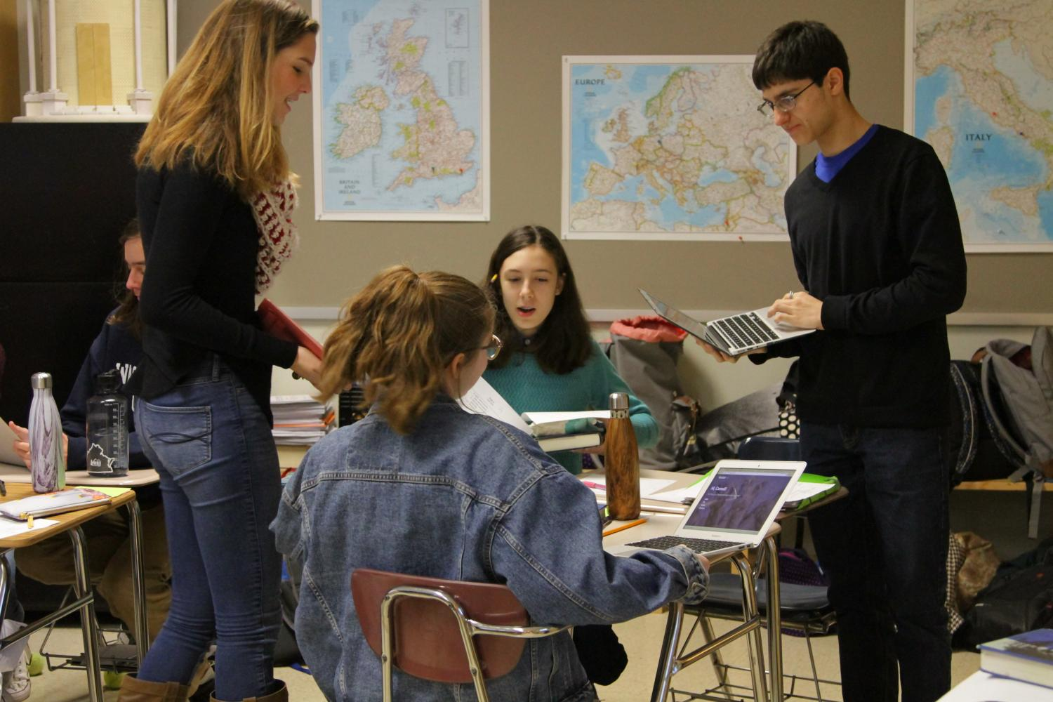 Image courtesy of Victor O'Neill Studios.  Sophomores Draken Garfinkel, Lily De Benigno, Julia Billera and Reilly Halvorson work in Latin class.