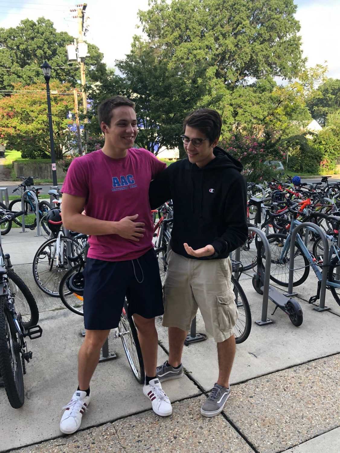 Juniors Noah Toth, right,  and Jack Mowry hang out around the bike racks. They are the organizers of the Bike for Cancer fundraiser.
