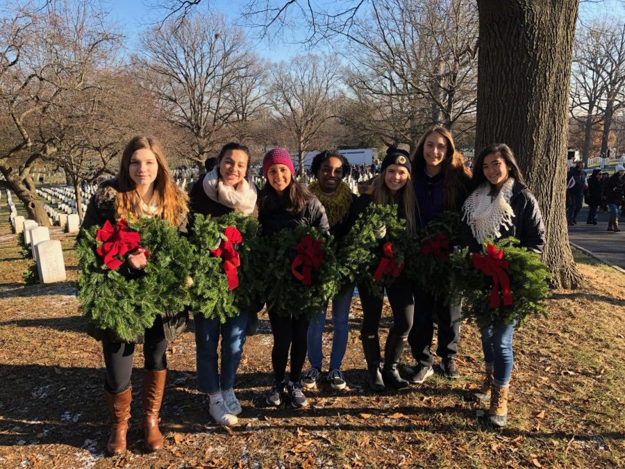 Action+team+members+stand+proudly+in+front+of+the+Arlington+National+Cemetery%2C+just+after+laying+wreaths+on+the+gravestones.+Action+Team+hopes+to+complete+many+more+service+activities+for+future+holiday+seasons.+
