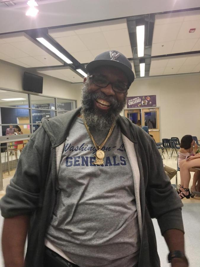 Mr.+Glenroy+joining+in+the+fun+at+the+Homecoming+Dance+of+2018.+Though+he+works+all+day+at+the+school%2C+he+still+finds+time+to+help+out+the+students+after+school+hours.