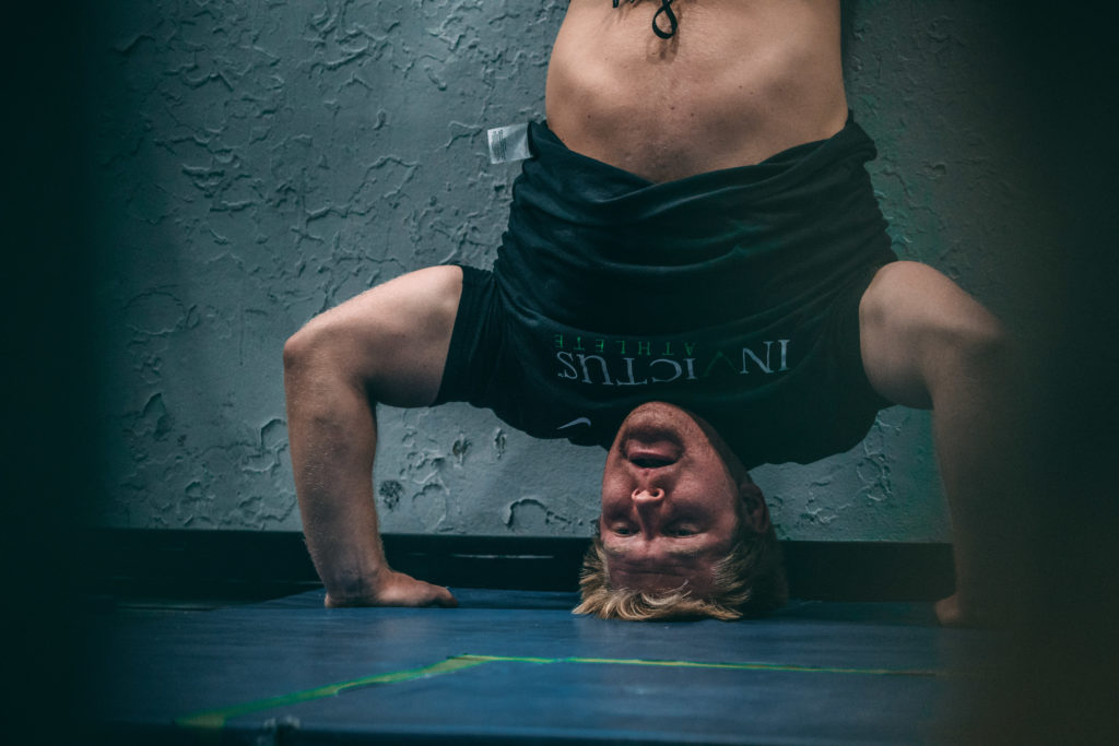 How To Do Handstand Push Ups Tips Tricks For Beginners
