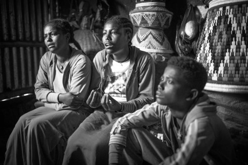 """Without adaptations for their disabilities, 'living alone is dangerous,' says Addisie (middle), the younger of two girls, emphasising their constant worries. """"There could be a fire, an electrical explosion, we wouldn't be able to hear it."""" Like their little brother, both sisters rather stay at home after school for fear of something happening to them."""