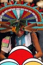 Corn grinding by Hopi girl during Social Dance by Sandra Cosentino