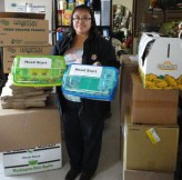 Part of the delivery for 50 Head Start kids--this is Jolene Johns, Special Needs Coordinator, Hopi Head Start. We also shipped coats, sweatsuits, gloves, socks, mittens directly from supplier after extensive research. Local shoppers were generous in buying learning games for the kids. (photo by Sandra Cosentino)