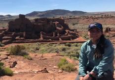 Hali-Lauren Lomayesva photo at an ancestor site during her field supervisor work with Ancestral Lands Hopi