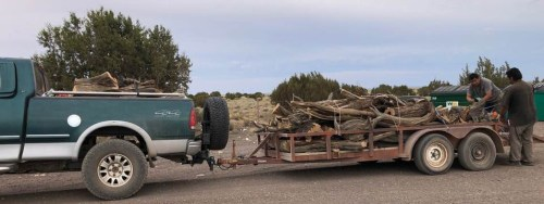 Hopi truck and trailer loaded with firewood shows work being done to supply firewood for elders in need.