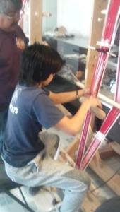 Hopi youth learning weaving skills and cultural meaning of weaving.