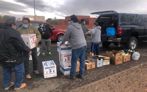 Hopi family food delivery in support of community leaders.