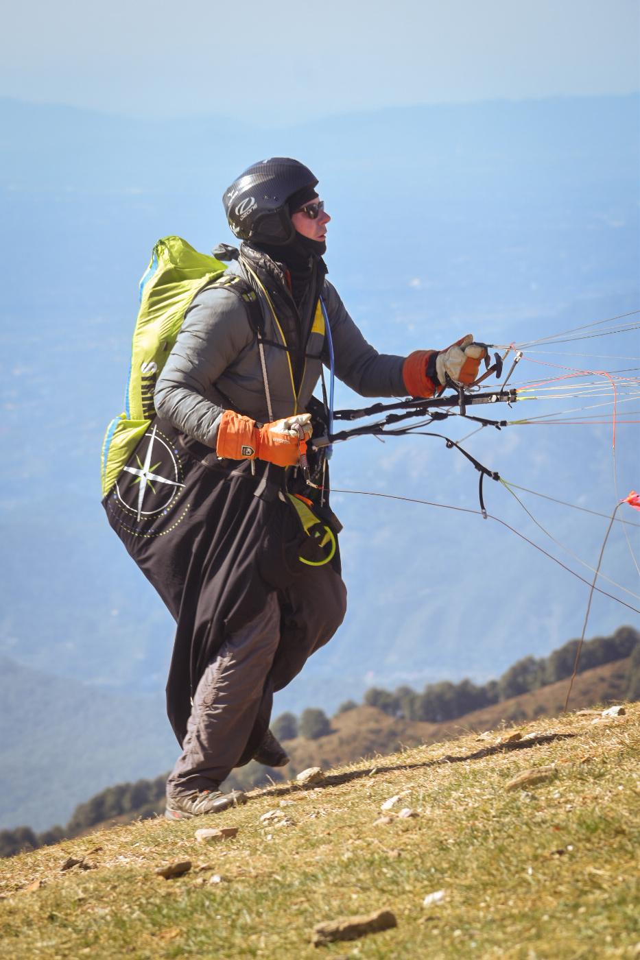 A Person Getting Prepared for Solo Paragliding