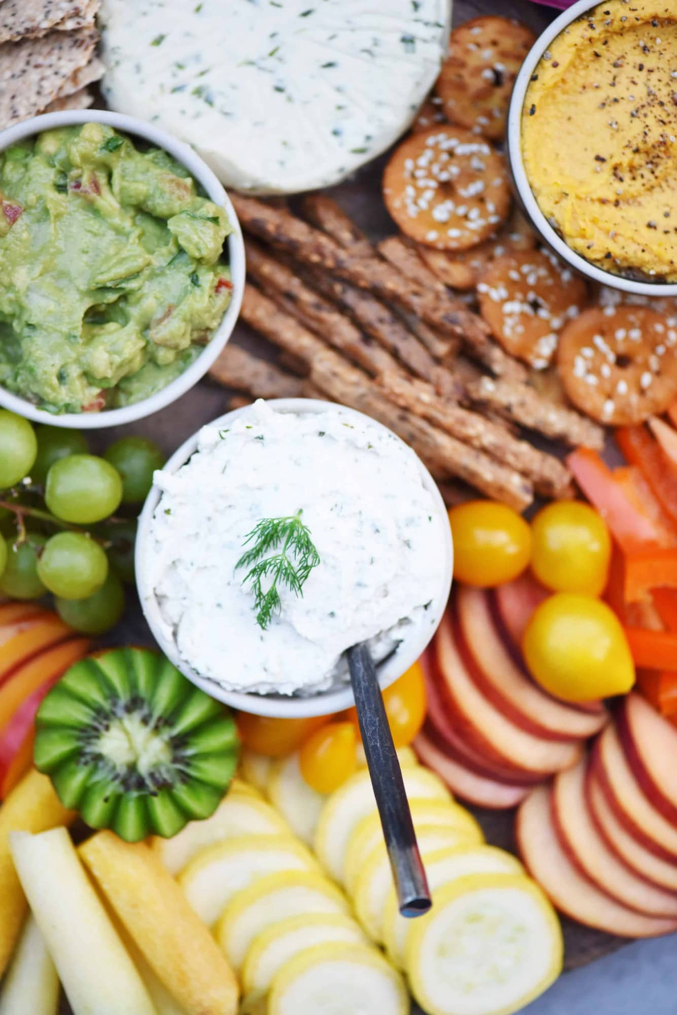 Close up of vegan chive dip on a rainbow snack platter