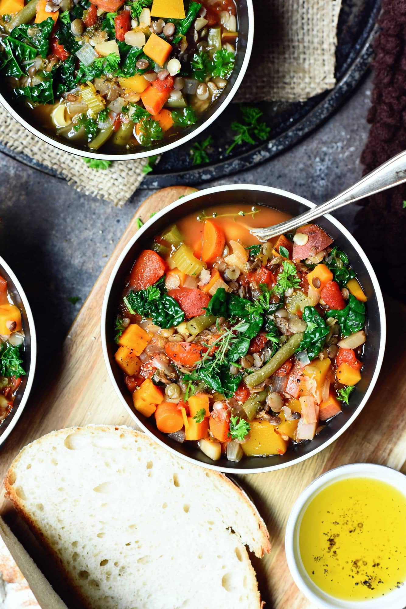 Overhead of lentil vegetable soup in black bowl