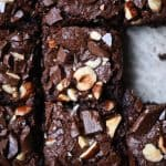 Overhead of tahini hazelnut brownies sliced into squares