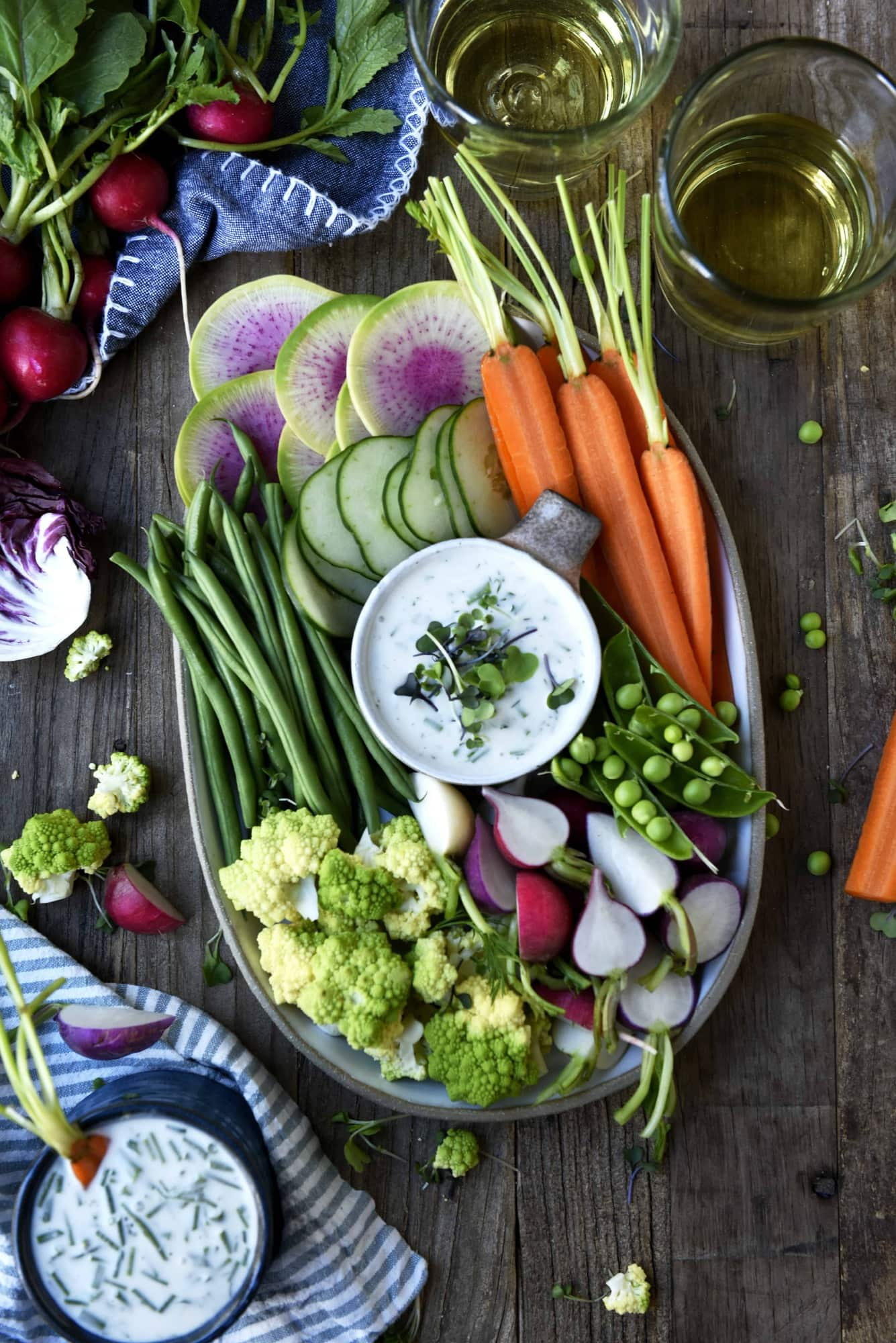Overhead of vegan ranch on a platter with fresh vegetables