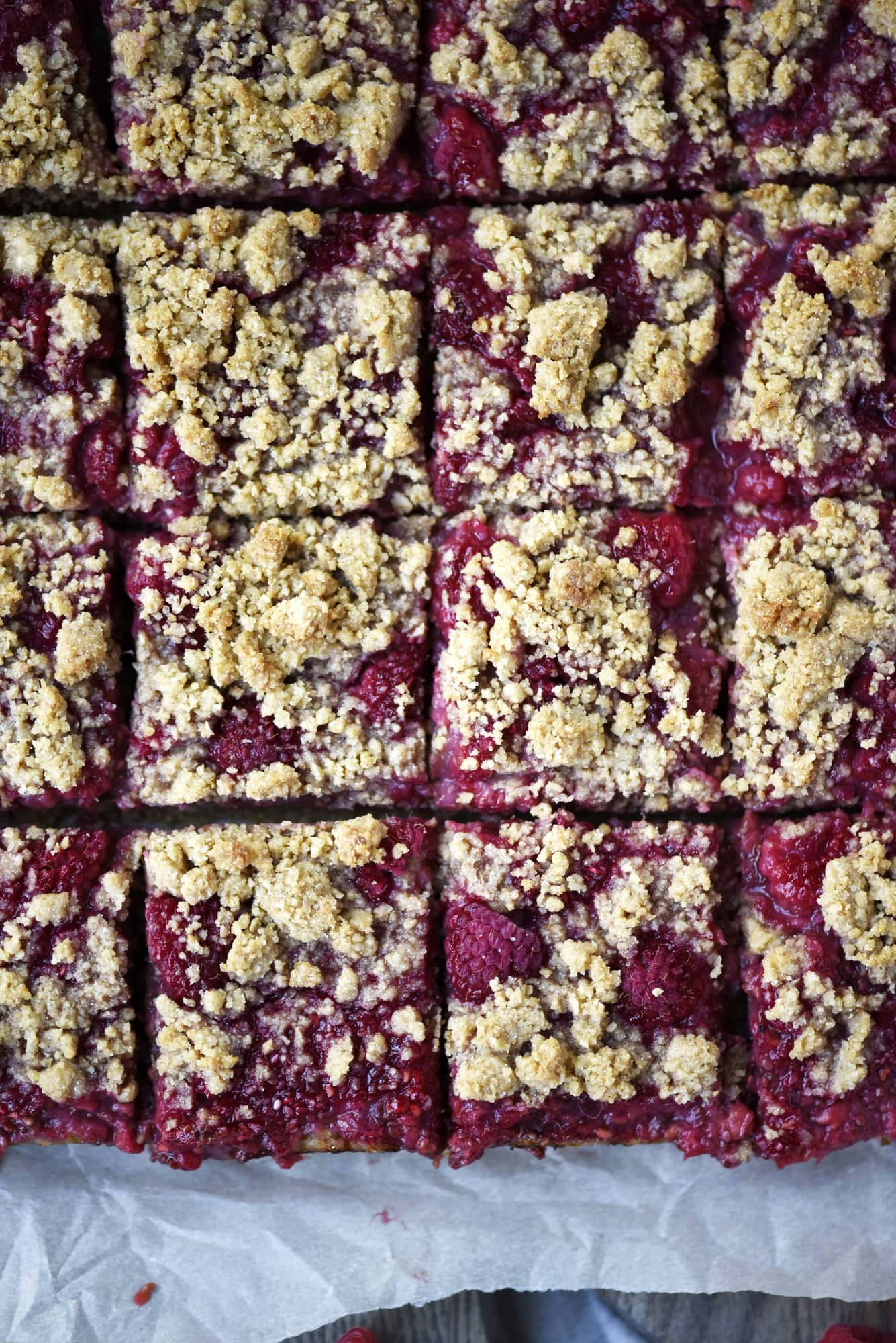 Overhead of sliced raspberry oatmeal crumble bars with streusel topping