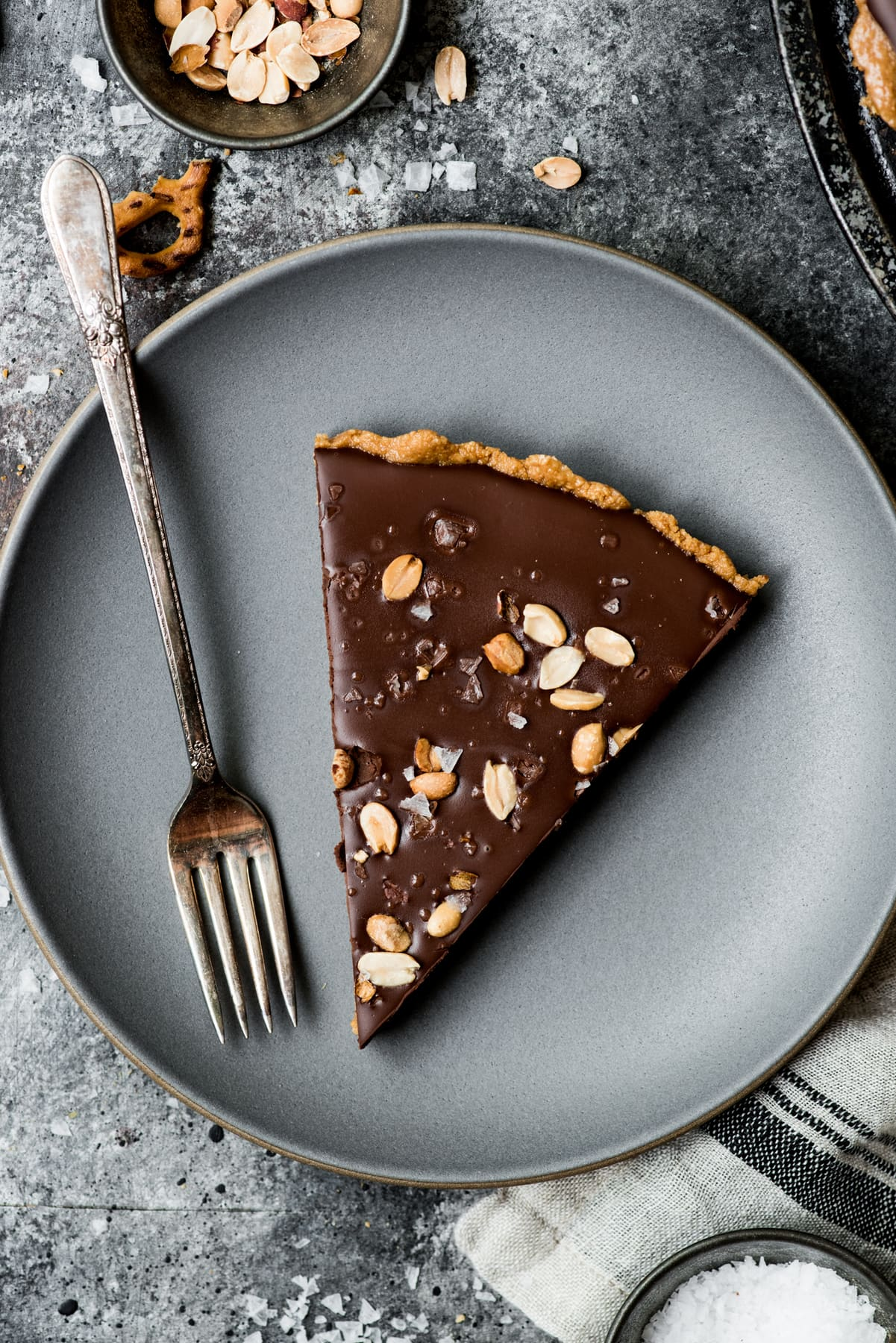 overhead view of vegan peanut butter chocolate pretzel tart on plates