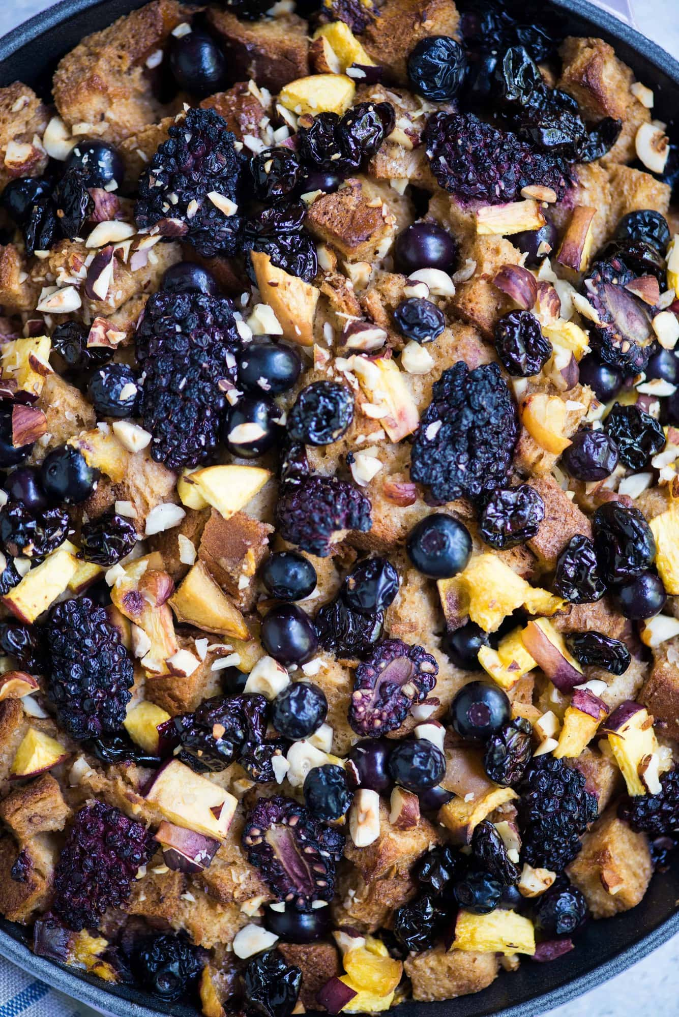Close up of baked blueberry nectarine bread pudding