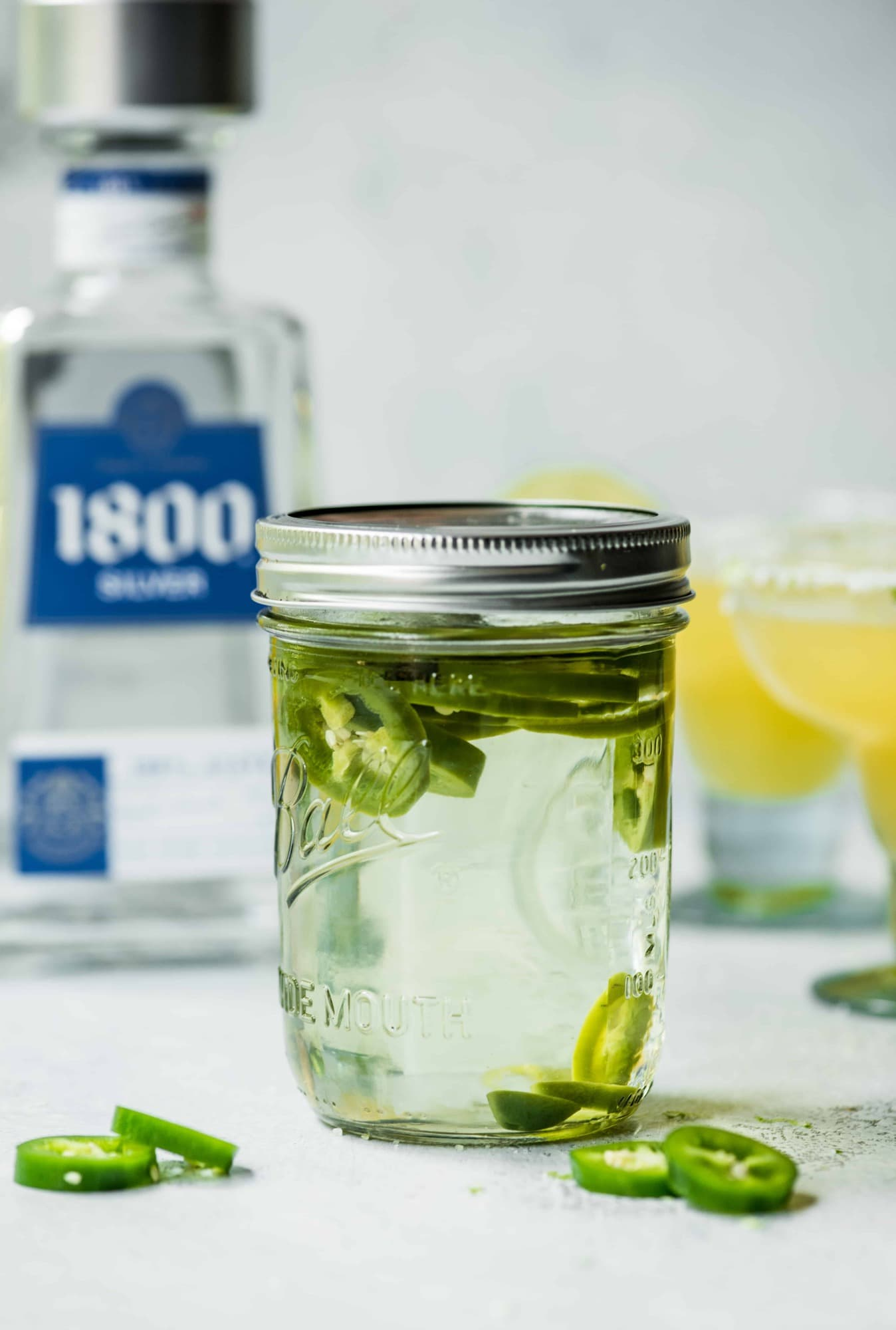 Jalapeno infused tequila in a glass jar
