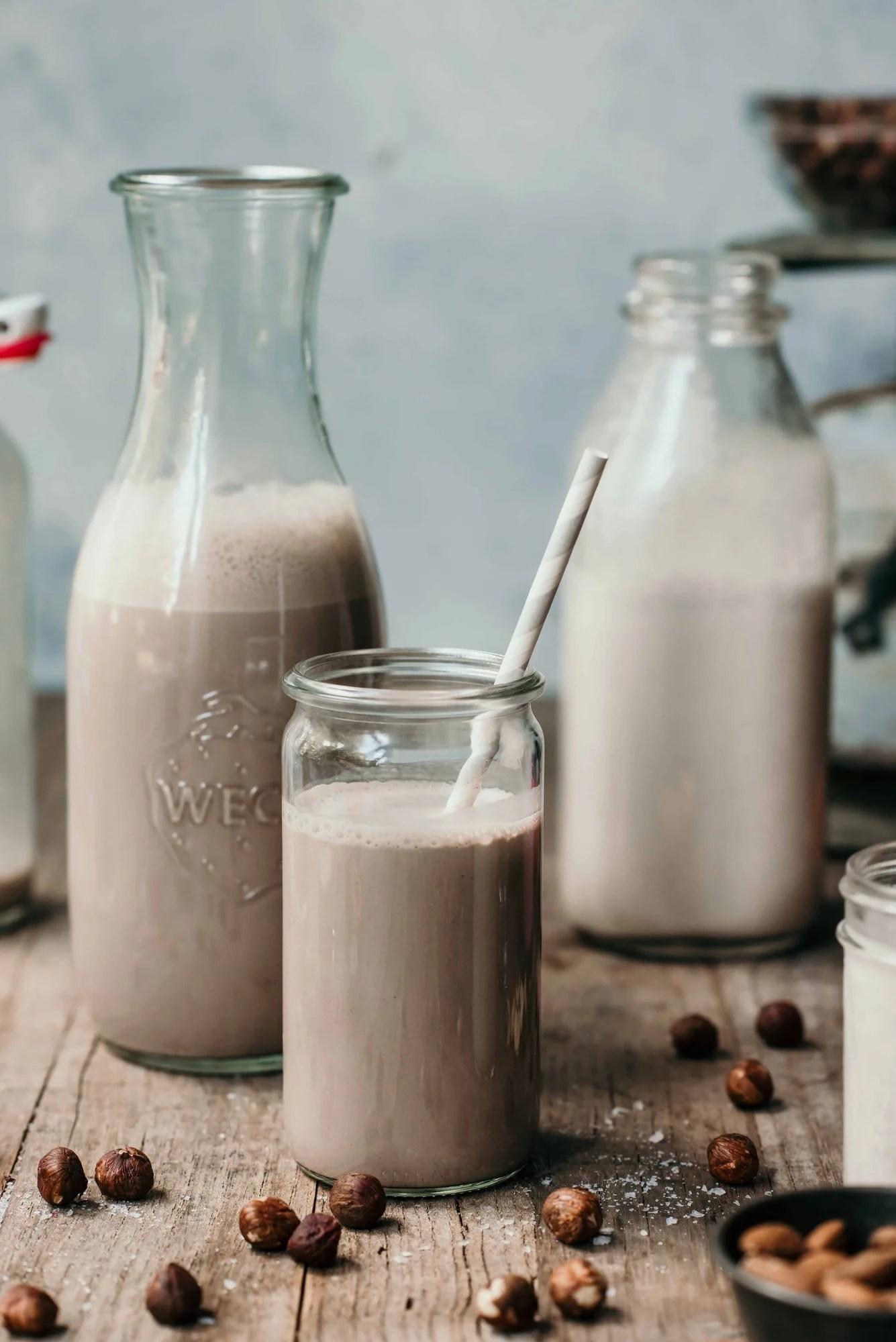 Homemade chocolate hazelnut milk in glass jars