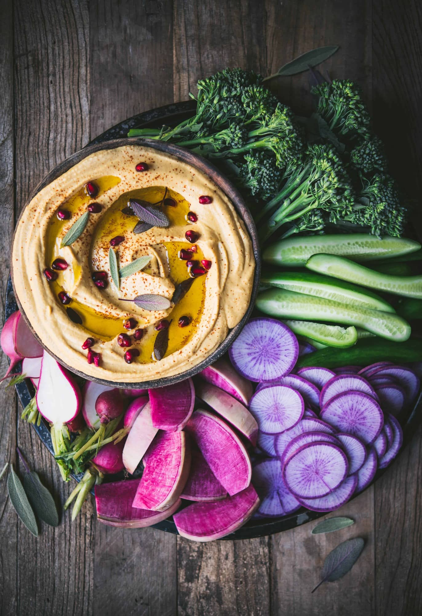 Colorful vegetable platter with bowl of creamy pumpkin hummus