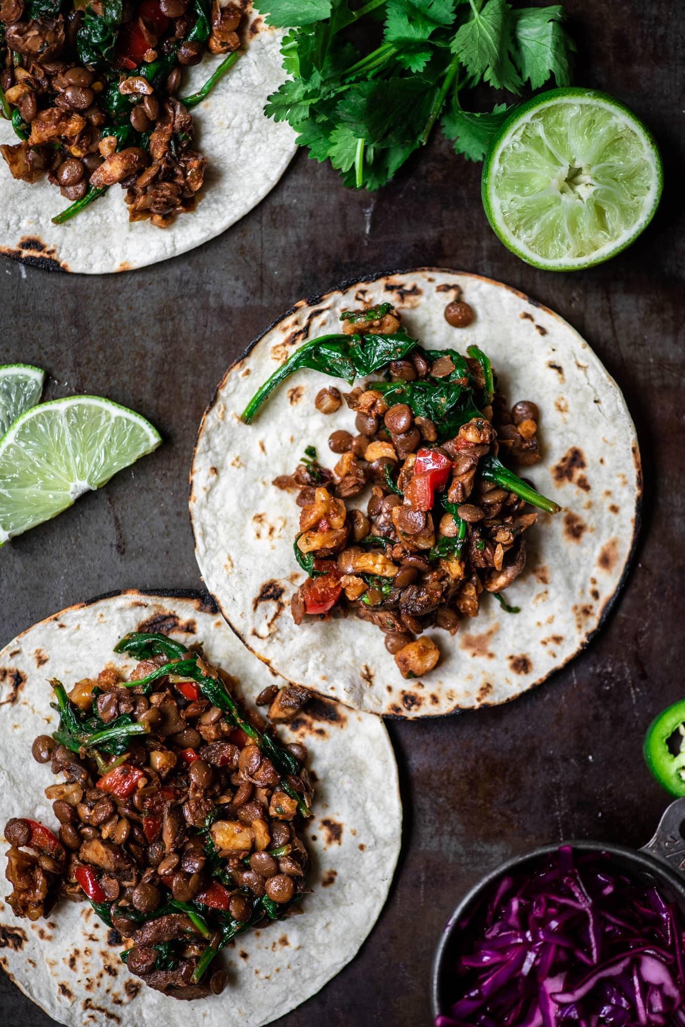 Overhead view of vegan lentil walnut tacos on tortillas