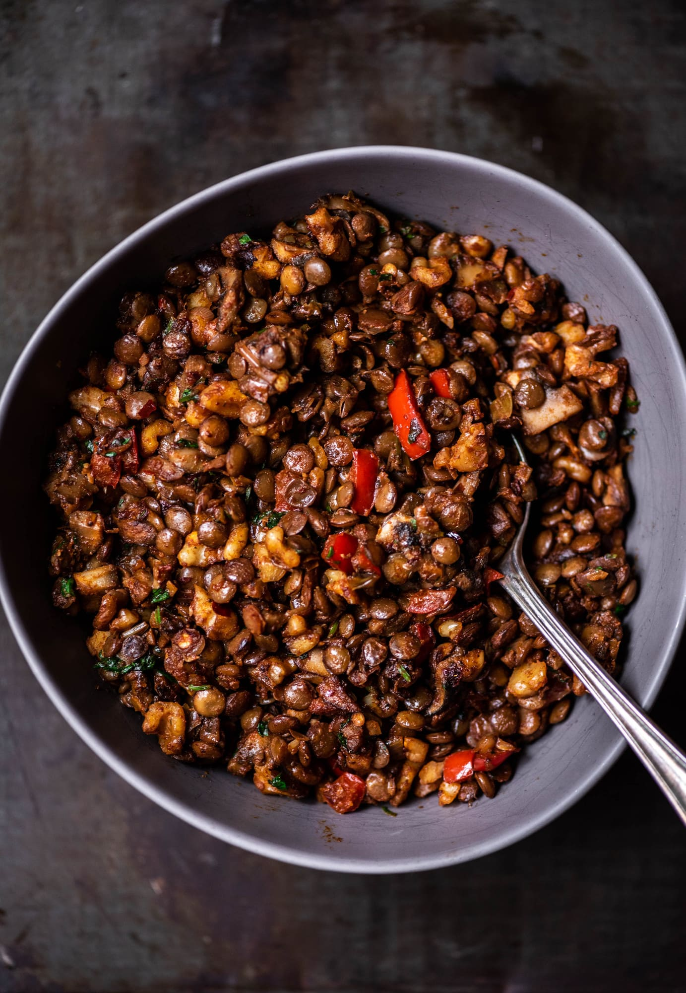 Close up of vegan lentil walnut taco filling in a gray mixing bowl