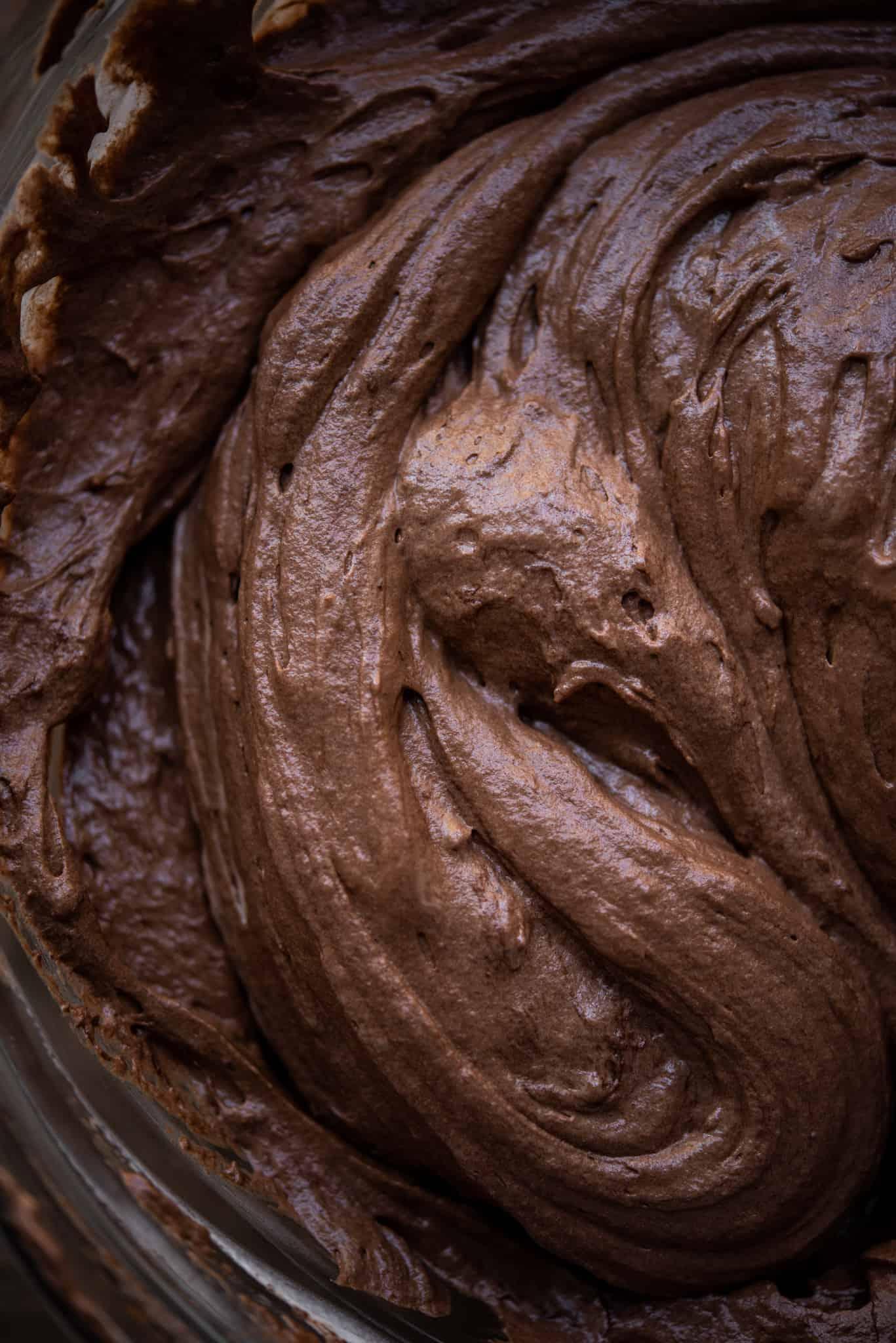 close up view of dark chocolate vegan mousse in bowl