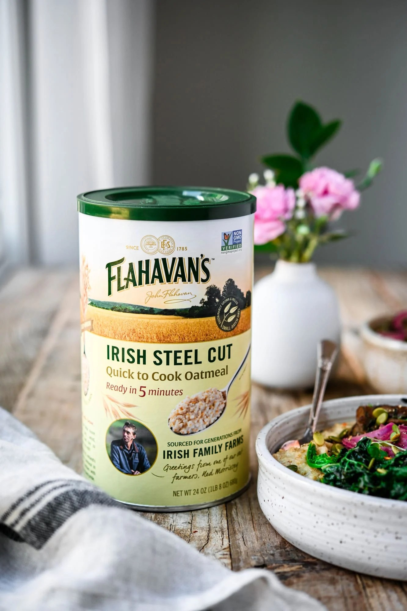 Side view of container of Flahavan's Irish Steel Cut Oatmeal on wood table