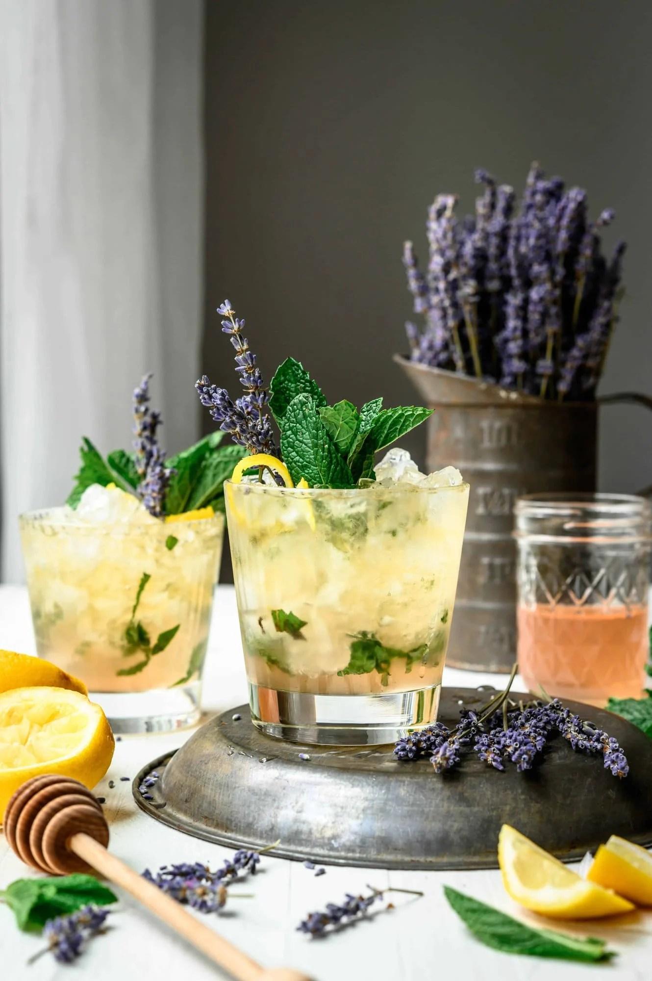 Side view of lemon lavender mint julep on white table