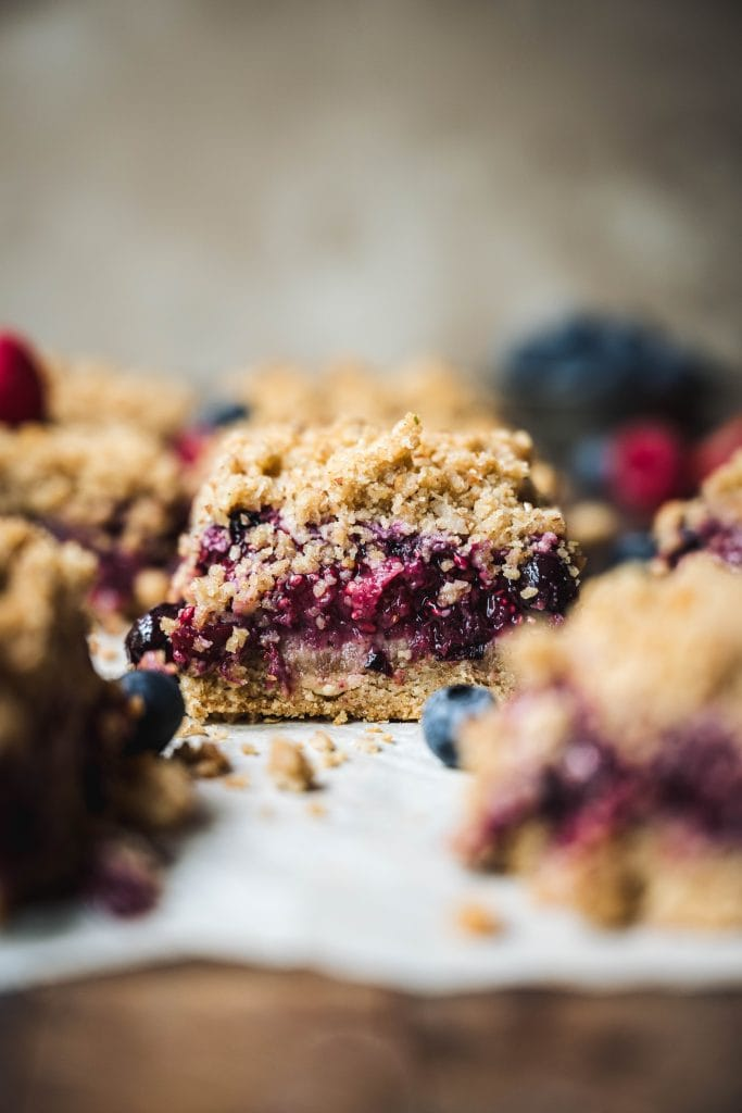 Side view of four berry pie bar with streusel topping