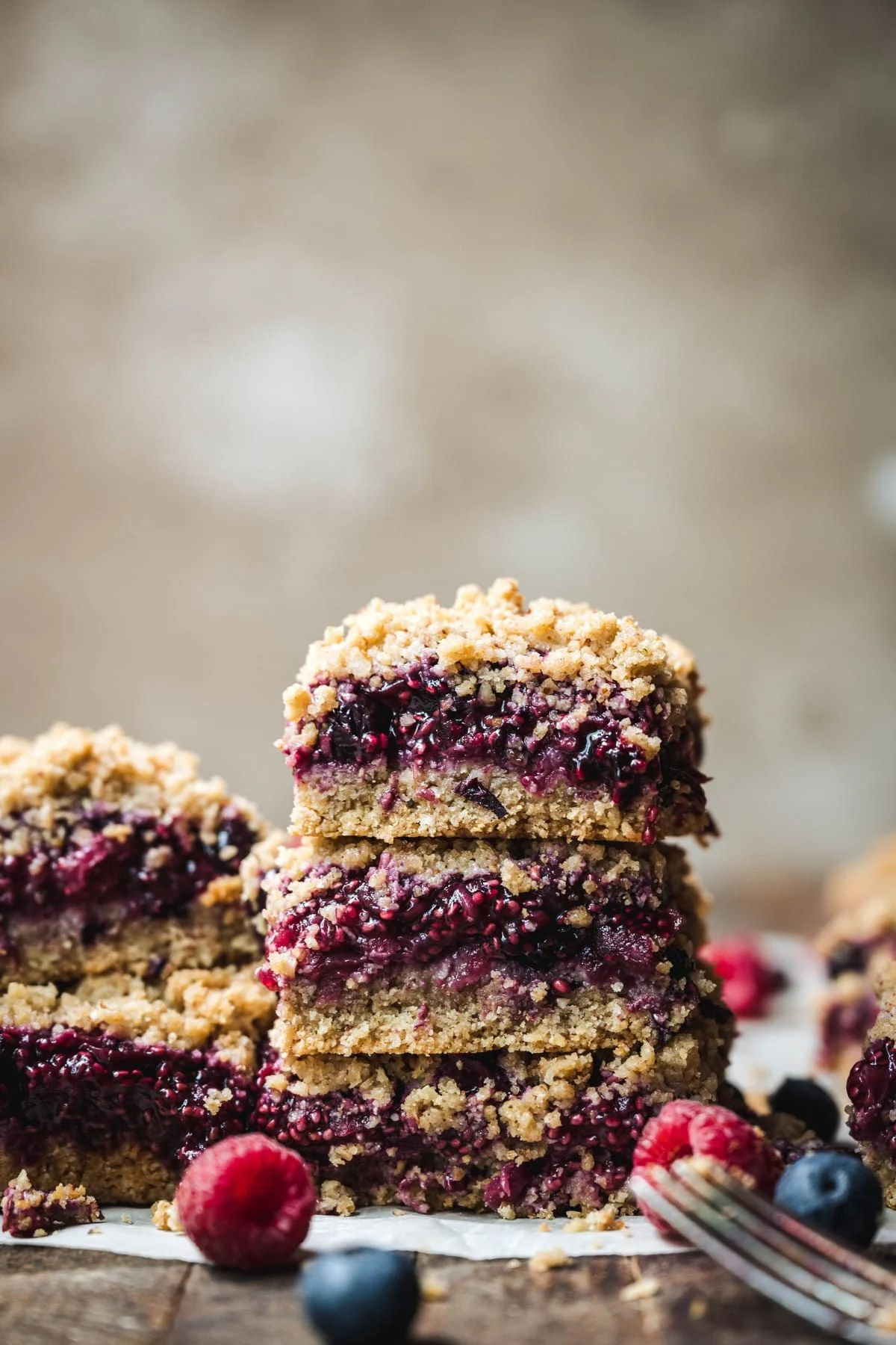 stack of gluten free four berry pie bars with fresh berries