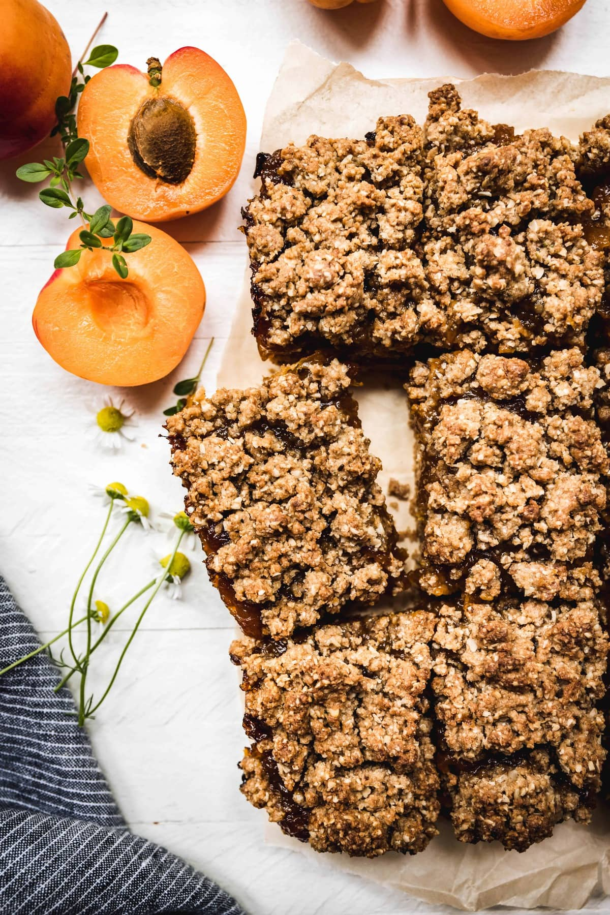 Overhead view of sliced vegan and gluten free apricot oat bars on parchment paper